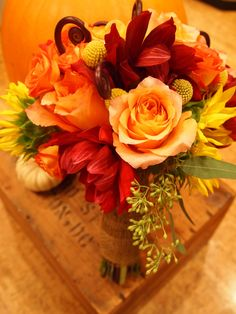 Fall bouquet. Floral design by Ever Ours. Red flower?
