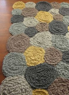Hand-crocheted wool rug, soft textured layers in shades of gray, taupe and yellow. 5'x8'.  $795 from VivaTerra catalog