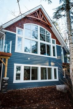 For over 40 years Cedarland Homes has been the builder of beautiful homes and cottages in the Parry Sound, Muskoka and Georgian Bay regions. Blue Siding, Exterior Siding, Exterior Paint, Cottage Exterior, Exterior House Colors, Fairy Garden Houses, New Home Designs, Carriage House, Deco