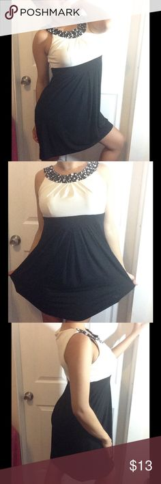 Black & White Cocktail Dress Nice dress for any occasion. Rocked it maybe once or twice. It has minor yellowish/ brownish  stains on the white part that the camera didn't capture. It's really not that visible and can be gone. Try dry cleaners. 👗Open for a reasonable offer or trade for this. Intermission Dresses Midi