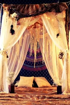 Gypsy-like bed with jewel tones & an ethereal feel.