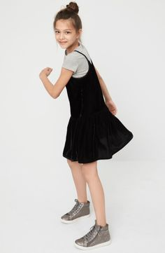 She can channel '90s cool-girl style by wearing this tee and velour tank dress together, or mix and match them as separates for extra versatility.