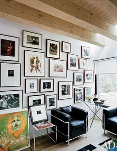 The office in this Santa Fe, New Mexico, home features white-matted, dark-framed images by Bill Brandt, Annie Leibovitz, Herb Ritts, Bruce Weber, Weegee, and others.