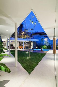 Spectacular house in Sao  Paulo, Brazil  by FGMF Architects - intended as a multigenerational family home where members can reunite, sunbathe near the pool and enjoy this lavish central courtyard  ~ Great pin! For Oahu architectural design visit http://ownerbuiltdesign.com