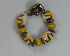 A Kazuri bracelet  made from handmade Kazuri beads. See more Kazuri Bracelets at http://www.vpsjewelry.com/kabr.html