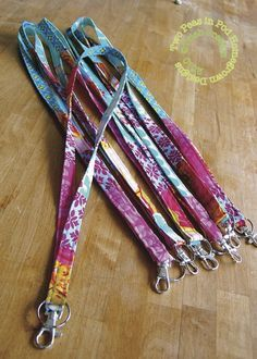 making lanyards from fabric scraps~ So like most school staff know, part of the daily dress code is one's name tag, often clipped to a lanyard. The lanyard provided by employers is usually a plain cheep shoelace-like material. Blah. I wanted something more exciting! Something that would express my individuality. These DIY lanyards are fun and stylish!