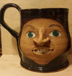 Check out this item in my Etsy shop https://www.etsy.com/listing/220323077/paula-bowers-ceramic-face-mug-extra