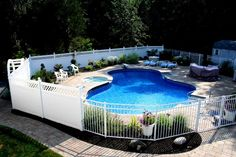 Elegant Pool Fencing Ideas with Green Surroundings : Beautiful House Pool With Hot Tub Exciting White Pool Fencing Ideas