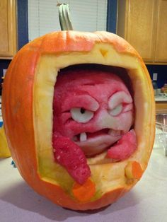 Using a watermelon and a pumpkin, carve each fruit to look as though a monster or creature (the watermelon) is crawling out of the pumpkin. Our Pumpkin Carving Kits can be easily used to achieve this design (http://www.pumpkinmasters.com/pumpkin-carving-kits.asp). Idea via Architecture Art Designs.