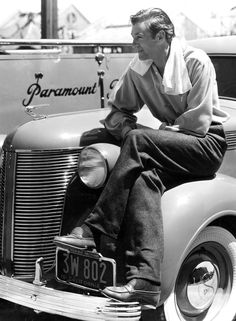 Gary Cooper sits on the fender of his De Soto on the Paramount lot, 1937
