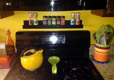 Pinner repurposed a display ledge shelf as a cute spice rack :) She got this one at Hobby Lobby Kitchen Aid Mixer, Kitchen Appliances, Ledge Shelf, Spice Racks, Barbie Dream House, Hobby Lobby, Organization Hacks, Repurposed, Spices