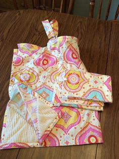 A personal favorite from my Etsy shop https://www.etsy.com/listing/256538361/nursing-cover-2-burp-cloths-set