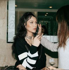 Bella Hadid's Best Fashion Week Beauty Moments, from Messy Waves to Sleek Top Knots Photos | W Magazine