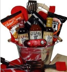 """This galvanized bowl comes filled with Stubb's BBQ sauce three BBQ utensils with wooden handle (fork, tong and spatula), a silicone BBQ brush, a pot holder, 15"""" jumbo mitt and a kitchen towel. While you wait for your meat, you can enjoy the Heart of Wisconsin sausage (5oz.), Snack Factory buffalo wing pretzel crisps and Route 11 BBQ potato chips as a snack etc.  Don't show up empty handed to your next BBQ get your gift basket at delightexpression.com"""