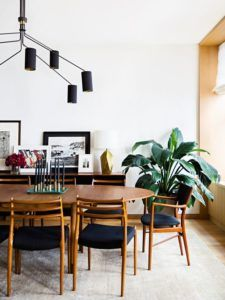 Stylish midcentury modern dining room with beautiful wooden dining furniture