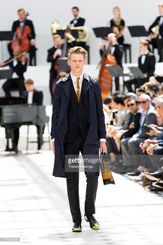 A model walks the runway at the Burberry Prorsum show during The London Collections Men SS16 at Kensington Gardens on June 15, 2015 in London, England.