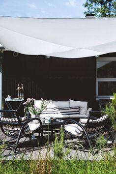 Comfy patio with homemade shade.