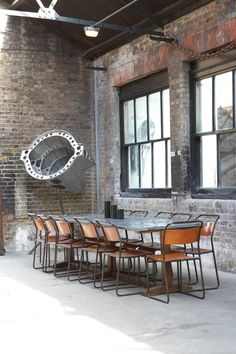 A really industrial dining experience, brick walls, high ceilings with metal beams and a huge reclaimed table and chairs.