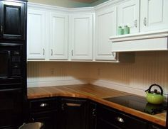Beadboard wallpaper backsplash for the kitchen! We went with tile, but still love this look!