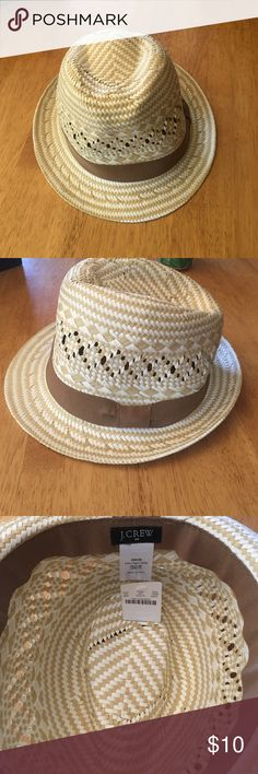J crew fedora hat White and tan j crew fedora hat. I bought it and then never wore it. It is brand new! With tags still J. Crew Accessories Hats