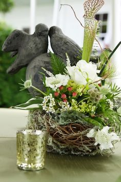 10. #Rustic Floral Bird's Nest - 21 Rustic #Wedding #Centerpiece Ideas... → Wedding [ more at http://wedding.allwomenstalk.com ]  #Idea #Vase #Vintage #Fabric #Pewter
