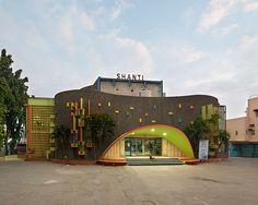 vibrant façades animate movie theater architecture in south india