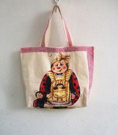 Bolsa em tecido de algodão de lonita, pintada à mão.