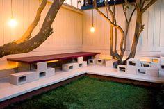 Stack Cinder Blocks for Easy Outdoor Seating - Cool Backyard Ideas: 19 Free Upgrades for Your Outdoor Living Room - Bob Vila Cinder Block Furniture, Cinder Block Bench, Cinder Block Garden, Cinder Blocks, Brick Block, Backyard Lighting, Concrete Blocks, Diy Concrete, Decorative Concrete