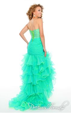Precious Formals Style P52018 This long high low dress has a sequined bodice with a pleated drop waist and waves of organza flowing down the skirt.