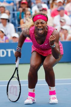 Pin for Later: The Most Compelling Pictures of 2014  Tennis champion Serena Williams celebrated during the women's singles third-round match during the US Open in NYC.