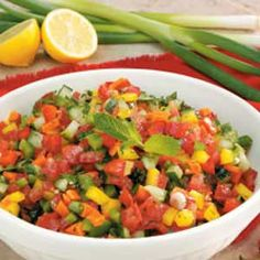 """Israeli Pepper Tomato Salad Recipe -""""This Israeli salad, which is traditionally eaten at breakfast, lends itself to endless variety...you can add foods like olives, beets or potatoes,"""" says Sandy Long of Lees Summit, Missouri"""
