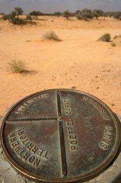 A sign at Poeppel Corner in the Simpson Desert, South Australia. Photo: Alamy
