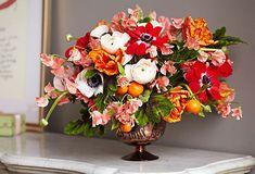 anemone, parrot tulips, sweet peas, geranium leaf, ranunculus and kumquats