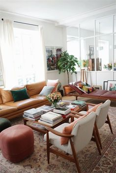 I dislike this look. I'd like to move away from iconic mid century stuff. It fits our home, but I like to push the boundaries and get more textures and stronger colors. I also strongly dislike 'frumpy' couches.