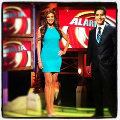 Lianna Grethel wearing Abyss by Abby's electric dress in teal.  Lianna is the host of Alarma TV on Estrella TV Network (their highest rated show) and looks absolutely AMAZING in this dress!
