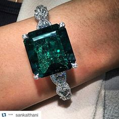 A closer look at the 38.51 carats Colombian no oil emerald and diamond bangle which is the largest of its kind in auction history. Christies.