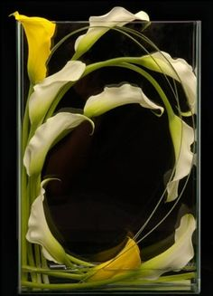 Calla Lillies artfully designed in a glass vase