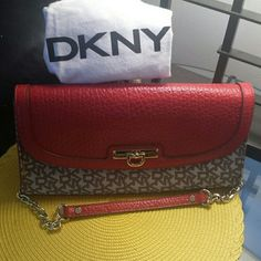 Deal of the day  DYNY RED LEATHER AND CLOTH Nwot DKNY red leather trim and cloth bag with removable strap to use a clutch.  Strap is gold chain and red leather. Comes with dust cover. Never used new condition. DKNY Bags