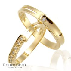 Gold engagement rings with the subtle cutting-design  These rings have the subtle cutting-design in the sides. The brightly small stones simulated diamonds are added around these rings to enhance value for them.