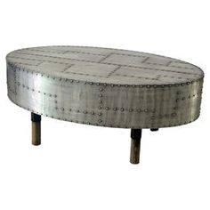"""Aluminum coffee table with studded detail.  Product: Coffee tableConstruction Material: AluminumColor: SilverDimensions: 15.75"""" H x 39"""" W x 23"""" D #conceptcandieinteriors"""