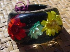 Vintage lucite ring with red yellow and teal straw flowers