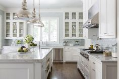 White Marble Kitchen, light grey subway tiles, shaker cabinetry - found on Melissa Haynes design website