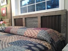 Rustic headboard. Hubs made from old lumber & corrugated metal.