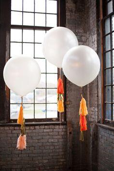Oversized wedding balloons | Photo by Lisa Berry | Read more - http://www.100layercake.com/blog/?p=76472 #balloons #weddingdecor #fringe