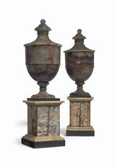 A PAIR OF ENGLISH BLUE-JOHN URNS  LATE 18TH/EARLY 19TH CENTRUY  Of typical form, above a turned socle on a black slate, white marble and blue-john stepped plinth  16 in. (41 cm.) high (2)