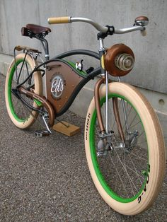 Cruiser Bike with some neat wee suspension springs on lower front forks, and an unusual front light setup