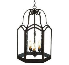 "10096A  THREE LIGHT IRON LANTERN FINISH SHOWN: TOLEDO SHOWN WITH FRENCH ANTIQUE GLASS, AVAILABLE WITH ANTIQUE SEEDY OR CLEAR GLASS MAXIMUM WATTAGE: 180 CANDELABRA BASE SOCKETS HT 22"" W 14"" APPROX. WT. 20 LBS."