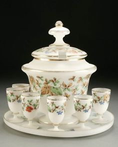 A FINE FRENCH OPALINE PUNCH SET 20th century, consisting of a covered punch bowl a large tray and eight tumblers, each decorated with red and blue flowers on brown stems