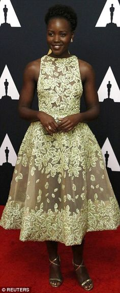 Floral lady:Lupita Nyong'o wore a flower patterned dress with sheer elements and a volumi...