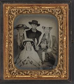 Unidentified soldier with three unidentified women in bonnets and one unidentified man from Liljenquist Family Collection of Civil War Photographs. #cw150